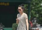 热浪袭哈尔滨 市民游客穿上清凉装