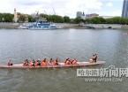 端午节龙舟赛开赛在即 参赛队伍江上训练