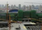 哈尔滨南站房建设主楼开始封顶(组图)