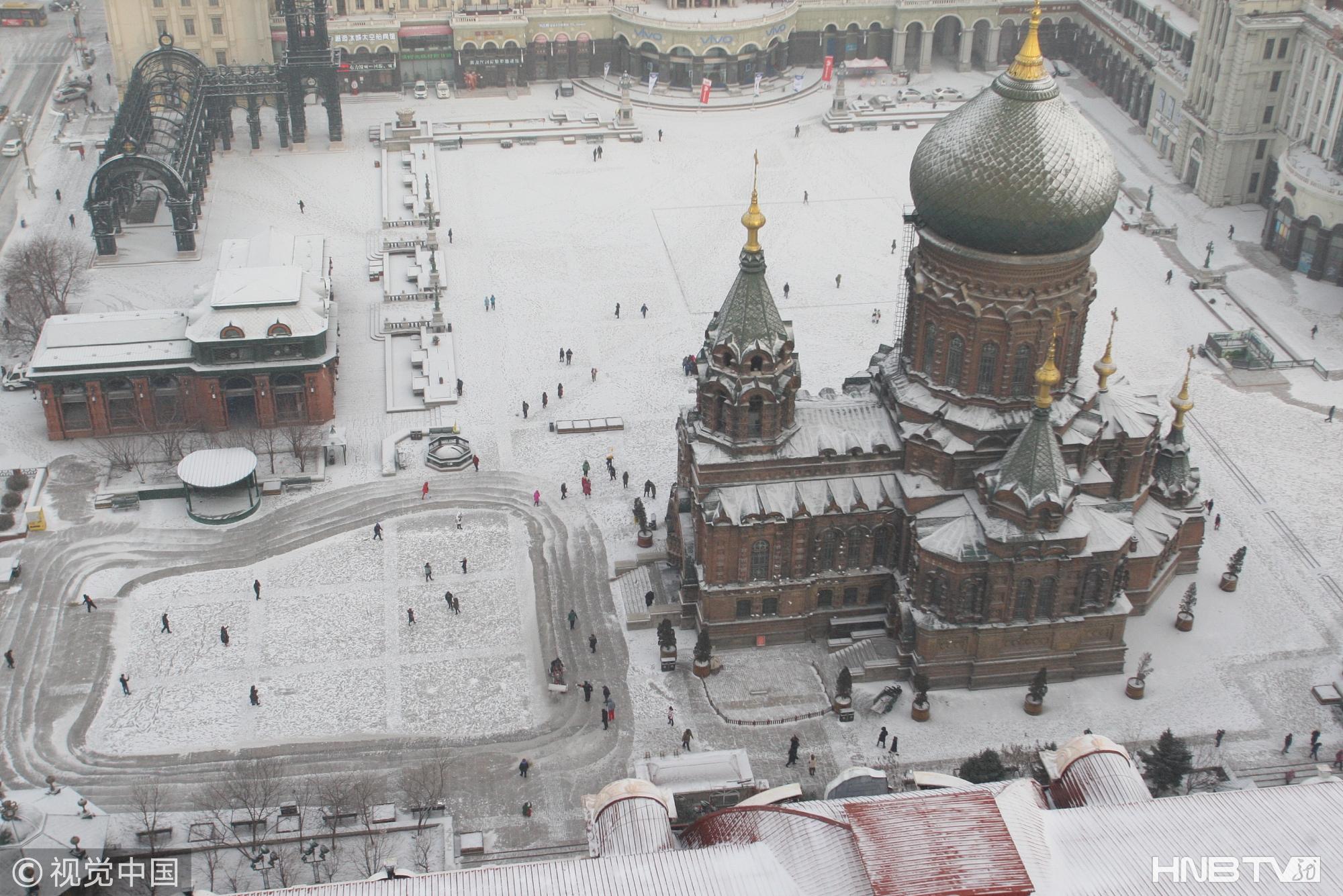 哈尔滨再迎降雪  整个城市银装素裹(组图)